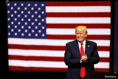 U.S. President Donald Trump takes the stage for a rally at the U.S. Cellular Center in Cedar Rapids, Iowa, U.S.