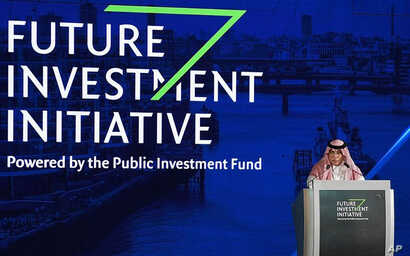 FILE - In this photo released by Saudi Press Agency, SPA, Saudi Minister of Commerce and Investment Majid al-Qasabi talks to the audience at the opening of Future Investment Initiative conference in Riyadh, Saudi Arabia, Oct. 24, 2017.