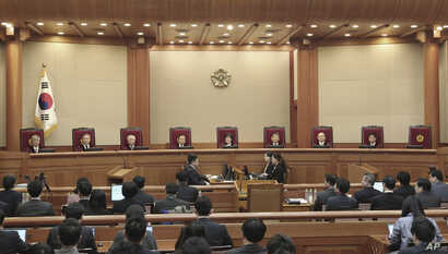 Judges of the Constitutional Court sit during the final hearing on whether to confirm the impeachment of President Park Geun-hye at the Court in Seoul, South Korea, Feb. 27, 2017