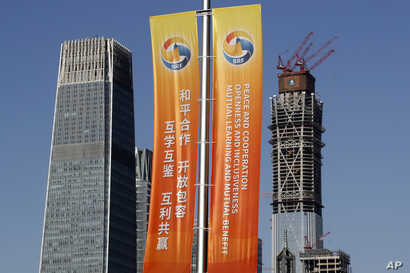 Banners promoting the Belt and Road Forum for International Cooperation are placed between skyscrapers in the central business district in Beijing, May 11, 2017.