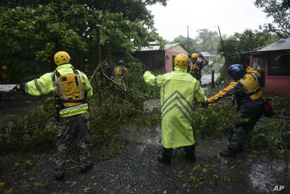 Rescuers from the Municipal Emergency Management Agency toured the streets of Matelnillo searching for anyone in distress during the passage of Hurricane Irma through the northeastern part of the island in Fajardo, Puerto Rico,, Sept. 6, 2017.