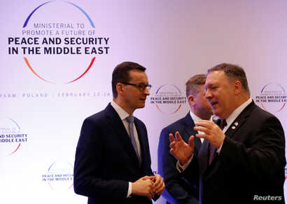 Poland's Prime Minister Mateusz Morawiecki and U.S. Secretary of State Mike Pompeo talk during a Middle East summit in Warsaw, Poland, Feb. 14, 2019.