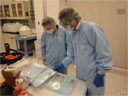 Researchers from US Army Medical Research and Material Command and the Department of Defense Space Test Program collaborate on the space health experiments. (USAMRMC)