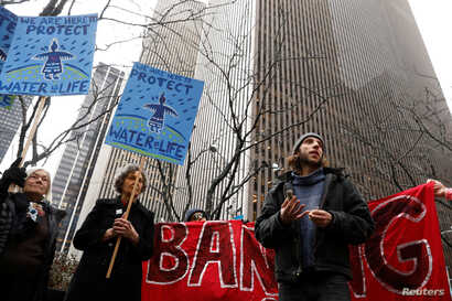 Demonstrators protest against the Dakota Access Pipeline, outside the Mizuho Bank in New York, Feb. 1, 2017.