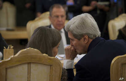 U.S. Secretary of State John Kerry, right, chats with Assistant U.S. Secretary of State for European and Eurasian Affairs Victoria Nuland, left, during a meeting with Russian Foreign Minister Sergey Lavrov, top,  in Moscow Tuesday, Dec. 15, 2015.