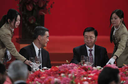 Hong Kong Chief Executive Leung Chun-ying, left, looks at Zhang Dejiang, right, chairman of China's National People's Congress, during a banquet in Hong Kong, Wednesday, May 18, 2016.