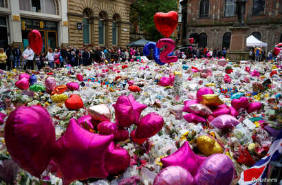 Flowers and tributes to the victims of the attack on Manchester Arena fill St Ann's Square in Manchester, Britain, May 29, 2017.