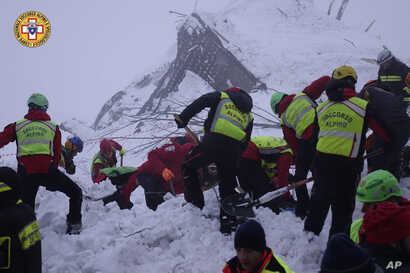 Rescuers work at the avalanche-hit Rigopiano hotel, Jan. 21, 2017.