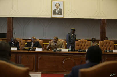 Essombe Emile, President of Cameroon Constitutional council, center, speaks during a meeting with representatives of the political parties and members of the Electoral commissions at the palais des congrès in Yaounde Cameroon, Oct. 10, 2018.
