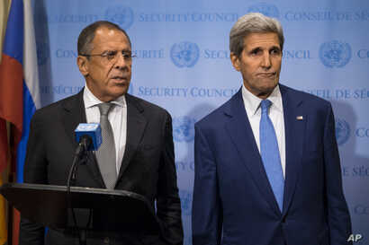 Russian Foreign Minister Sergei Lavrov, left, speaks during a news conference next to U.S. Secretary of State John Kerry at the U.N., Sept. 30, 2015.