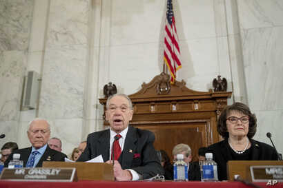 Senate Judiciary Committee Chairman Sen. Charles Grassley, R-Iowa, center, flanked by the committee's ranking member Sen. Dianne Feinstein, D-Calif., right, and Sen. Orrin Hatch, R-Utah, left, speaks on Capitol Hill in Washington, Jan. 10, 2017.