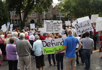 Hundreds of demonstrators gather outside the governor's mansion in St. Paul, Minn.,  Sept. 9, 2015, in a protest calling for Governor Mark Dayton to defund and investigate Planned Parenthood.