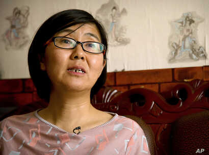 FILE - In this April 18, 2015 file photo, Wang Yu, a lawyer for Chinese activist Li Tingting, speaks during an interview in Beijing. China released the prominent human rights lawyer on bail amid protests Monday, Aug, 1, 2016, outside a northern city ...