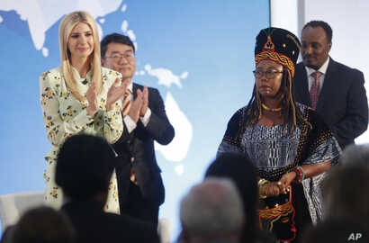 Ivanka Trump, left, the daughter and assistant to President Donald Trump, applauds after listening to a speech made by Francisca Awah Mbuli, right, from Cameroon and survivor of human trafficking, during an event to announce the 2018 Trafficking in P...