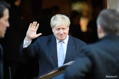 Foreign Secretary Boris Johnson leaves after listening to Britain's Prime Minister Theresa May deliver her keynote speech on Brexit at Lancaster House in London, Jan. 17, 2017.