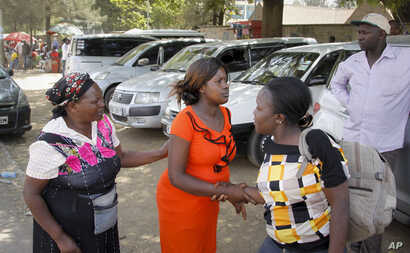 A pregnant Sharon Andisi, 23, arrives outside the Pumwani Maternity Hospital, Jan.9, 2017, only to be turned away because of a strike by state doctors, in Nairobi, Kenya. Such scenes have become frequent across Kenya as the doctors' strike stretches ...