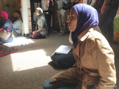 Worshipers sit and listen to prayers and a sermon at the Qal'bu Maryam Women's Mosque, which held its first service on Good Friday, at the Starr King School for the Ministry in Berkeley, California, April 14, 2017.