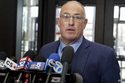 R. Kelly's defense attorney, Steve Greenberg, speaks to reporters at the Leighton Criminal Courthouse after the R&B singer entered a not guilty plea to all 10 counts of aggravated criminal sexual abuse, Feb. 25, 2019.