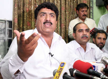 FILE - Jamil Afridi (left) brother of a Pakistani doctor Shakil Afridi, holds a a news conference in Peshawar, Pakistan, May 28, 2012. The brother of a doctor sentenced to 33 years for helping the United States track down Osama bin Laden, says that h...