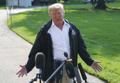 President Donald Trump talks to media before boarding Marine One on the South Lawn of the White House in Washington, Sept. 19, 2018, for the short trip to Andrews Air Force Base en route to Havelock, N.C.