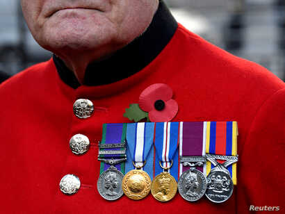 A veteran visits the Field of Remembrance at Westminster Abbey in London, Nov. 8, 2018.