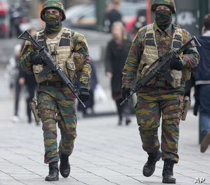 Belgian soldiers patrol outside a court building where Salah Abdeslam, the top suspect in last year's deadly Paris attacks, was expected to appear before a judge in Brussels, Belgium, March 24, 2016.