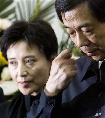 FILE - In this Jan. 17, 2007 file photo, Bo Xilai, right, then China's Minister of Commerce, and his wife Gu Kailai, left, attend a memorial ceremony for Bo's father Bo Yibo, a late revolutionary leader considered one of communist China's founding fa...