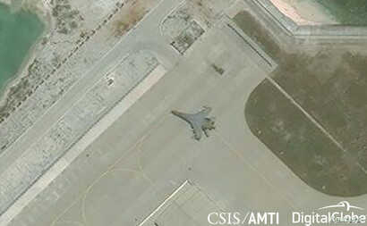 Satellite imagery shows the deployment of several new weapons systems, including a J-11 combat aircraft, at China's base on Woody Island in the Paracels, South China Sea, May 12, 2018.