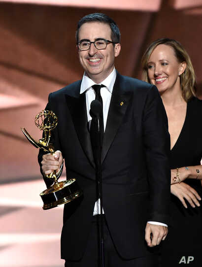 "John Oliver and the crew of ""Last Week Tonight with John Oliver"" accept the award for outstanding variety talk series at the 68th Primetime Emmy Awards on Sunday, Sept. 18, 2016, in Los Angeles."