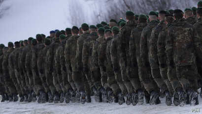 German Bundeswehr soldiers of the 122th Infantry Battalion take part in a farewell ceremony in Oberviechtach, Germany, Thursday, Jan. 19, 2017. As a part of the NATO program 'enhanced forward presence' 450 soldiers will move to Lithuania in the upcom...