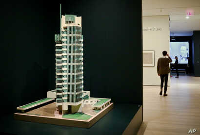 """A 1952 model of architect Frank Lloyd Wright's Price Tower hi-rise, which was built in Bartlesville, Okla., is displayed at the press preview for the MOMA exhibition, """"Frank Lloyd Wright at 150: Unpacking the Archive,"""" June 8, 2017, in New York."""