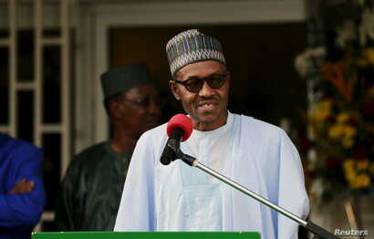 FILE - Nigeria's President Muhammadu Buhari speaks during a news conference after the Summit of Heads of State and Government of The Lake Chad Basin Commission (LCBC) in Abuja, Nigeria, June 11, 2015.