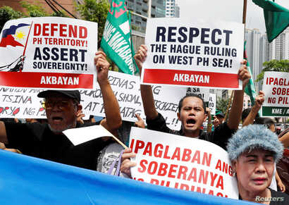 Members of the Akbayan activist group chant anti-China slogans as they march toward the Chinese consulate during a rally on the South China Sea dispute, in Makati, Metro Manila, in Philippines, July 12, 2018. Two years ago this month China lost a wor...