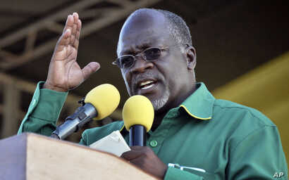 FILE - In this Oct. 23, 2015, photo, Tanzania President John Magufuli addresses a rally in Dar es Salaam, Tanzania.
