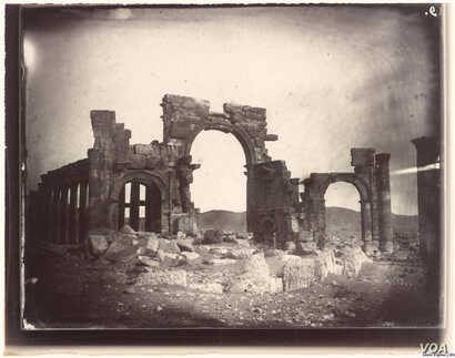 """The """"Monumental Arch"""" in Palmyra, Syria, photographed by Louis Vignes in 1864."""