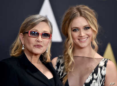 FILE - Carrie Fisher and her daughter, Billie Catherine Lourd, arrive at the Governors Awards at the Dolby Ballroom in Los Angeles, Nov. 14, 2015.