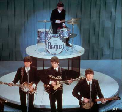 "In this Feb. 9, 1964 picture, The Beatles perform at the ""Ed Sullivan Show,"" in New York."