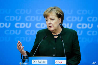 German Chancellor Angela Merkel addresses a new conference after a board meeting of her Christian Democratic Union party at the headquarters in Berlin, Nov. 27, 2017.