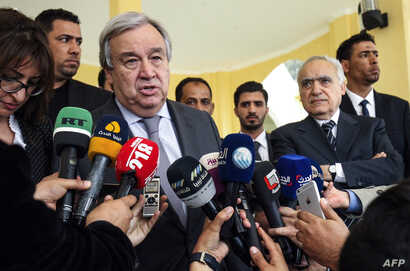 United Nations Secretary-General Antonio Guterres, left, speaks to the press before departing from Benina International Airport in Libya's eastern city of Benghazi, April 5, 2019.