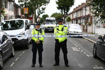 Police officers stand at a road block near a property in East Ham, east London, Britain, June 5, 2017.