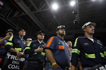 Coal miners listen as President Donald Trump speaks during a rally, Aug. 21, 2018, in Charleston, W.Va.