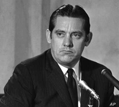FILE - This March 1, 1969, file photo shows Sen. Fred Harris of Oklahoma at a Democratic party commission meeting in Washington, D.C.