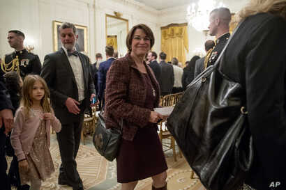 FILE - Sen. Amy Klobuchar, Democrat-Minnesota, departs following a ceremony in the East Room of the White House in Washington, Nov. 16, 2018.