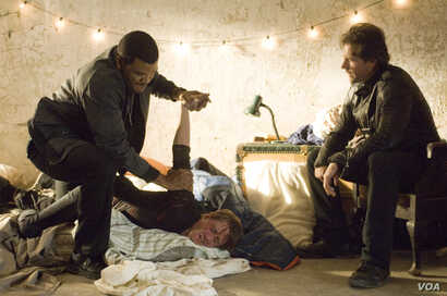 TYLER PERRY (left) and EDWARD BURNS (right) star in ALEX CROSS