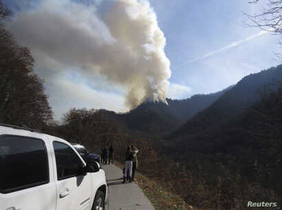 Motorists stop to view wildfires in the Great Smokey Mountains near Gatlinburg, Tennessee, U.S., November 28, 2016.