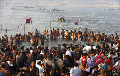 """Indian Hindu devotees gather to take holy dips at Sangam, the confluence of the Rivers Ganges, Yamuna and mythical Saraswati on Maghi Purnima, or the full-moon day of the month during the annual """"Magh Mela"""" fair in Allahabad, Feb. 10, 2017."""