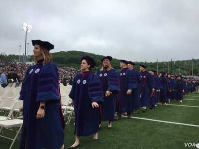 A group of Liberty University graduates file to the school's commencement ceremony, in Lynchburg, Virginia, May 13, 2017. (C. Presutti/VOA)