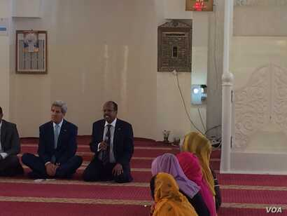 U.S. Secretary of State John Kerry, left, meets with young people at Salman Mosque in Djibouti, Djibouti, May 6, 2015.