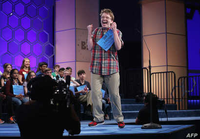 Speller Jacob Daniel Williamson of Cape Coral, Florida, reacts after he correctly spelled his word during round five of the 2014 Scripps National Spelling Bee competition May 29, 2014 in National Harbor, Maryland. Forty-six spellers have advanced to ...