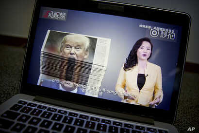 FILE - An online video about U.S.-China trade tensions produced by China's state television broadcaster plays on a computer screen in Beijing, China, Aug. 23, 2018.